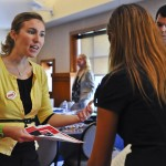Shannon Wagner of CDW talks to Corinne Ayoub, a senior Communications major at the Career Fair in the Rose Ballroom.
