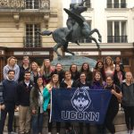 A group photo in front of a monument in Paris