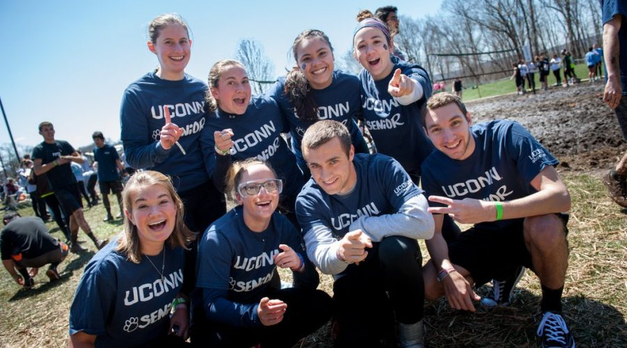 Eight seniors wear their UConn Senior branded tees at OOzeball