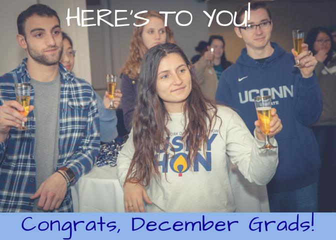 Picture of December Graduates toasting